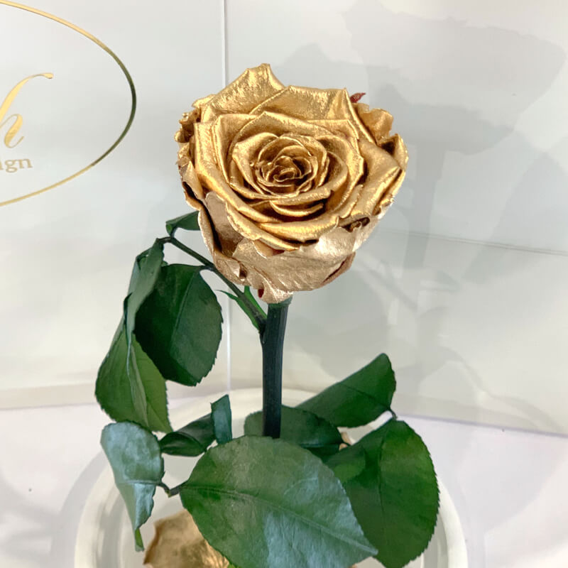 Gold Eternal Rose in Flask Lerosh - Classic 27 cm on a white stand